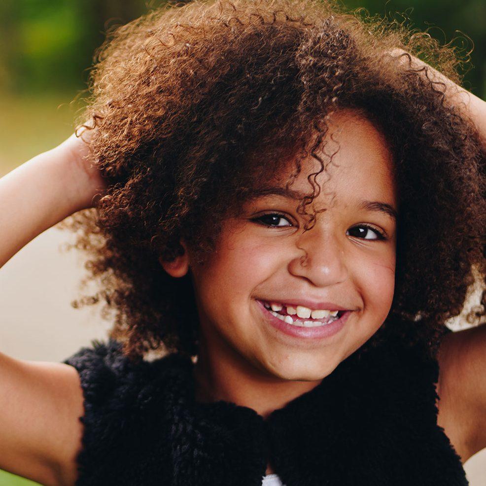 Child smiles after dentist
